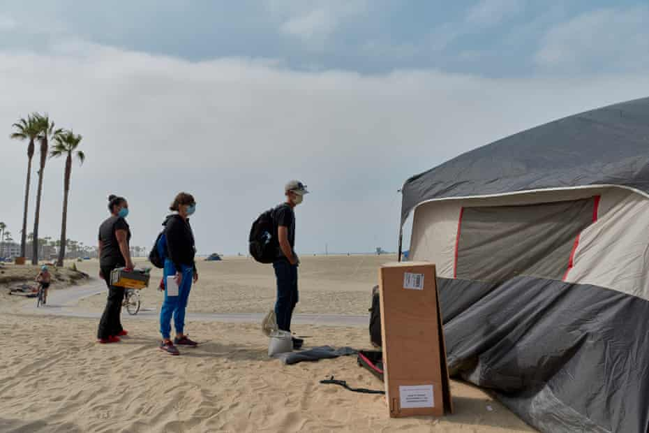 Dr Coley King offers assistance to unhoused people at Venice Beach.