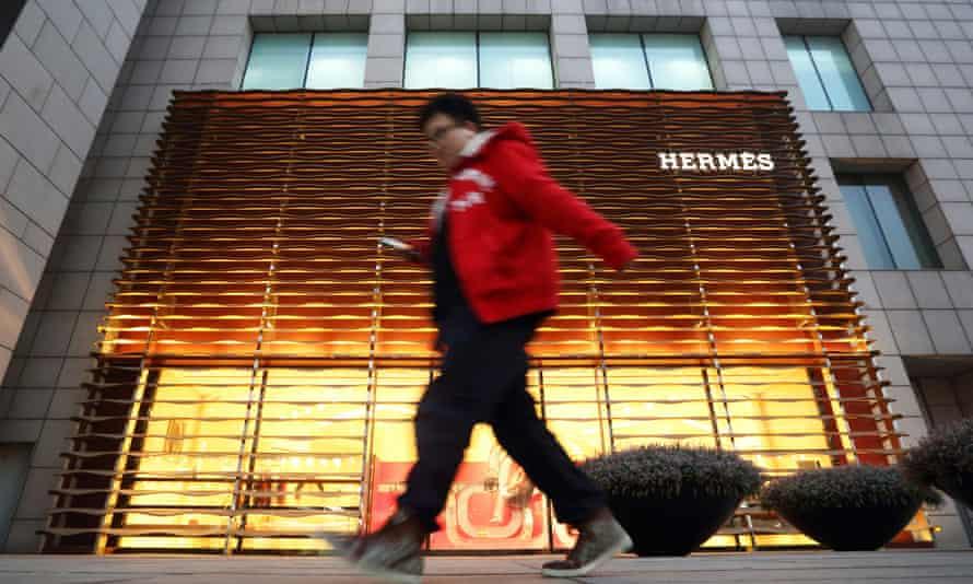 Man walks past Hermes shop