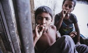 Boys smoking in Dhaka, Bangladesh