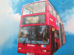 red London bus among blue sky and clouds