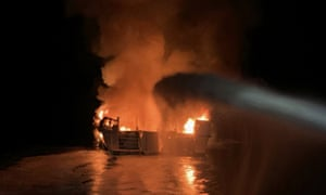 Firefighters respond to a boat fire off the coast of southern California Monday.
