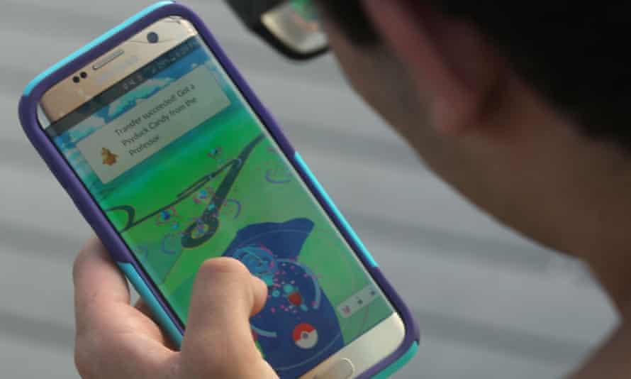 Man playing Pokemon Go on his phone