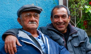 Celso Oviedo and his father Haroldo, outside the house the 86-year-old built and still lives in.