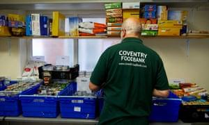 Volunteer preparing emergency food parcels at Coventry Foodbank
