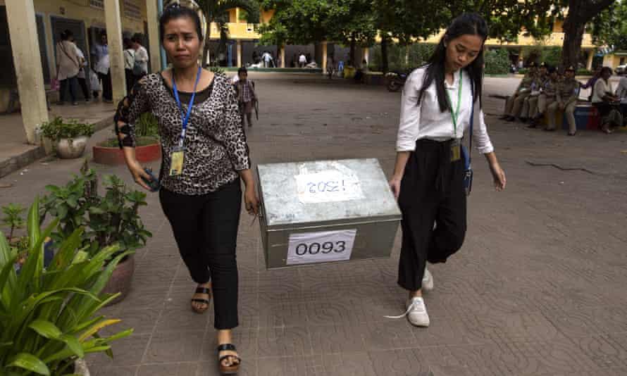 Women carry a ballot box in Phnom Penh, Cambodia