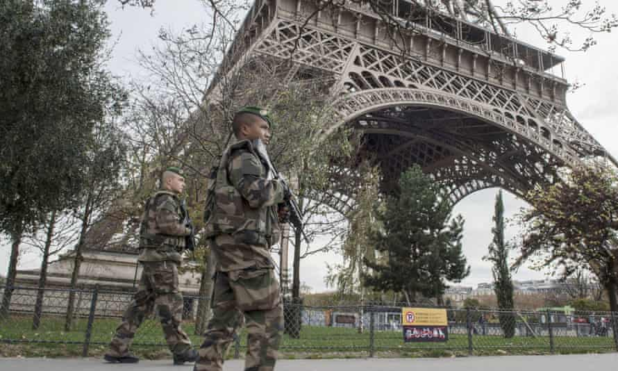 Soldiers on patrol at the Eiffel Tower
