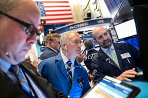Traders on the floor at the New York Stock Exchange last night.