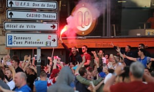 A flare is waved by an England fan in Lille city centre, where fresh clashes have taken place between supporters.