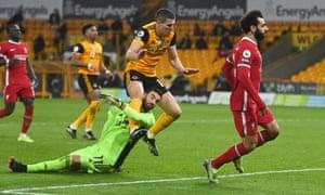 Conor Coady crashes into his goalkeeper Rui Patricio.