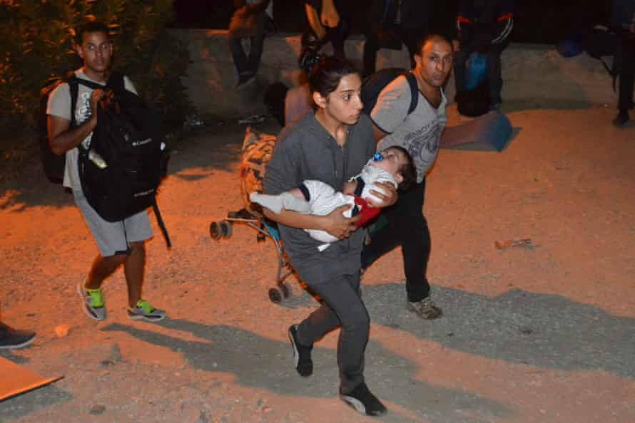 Refugees flee the camp of Moria on Lesbos island, Greece.