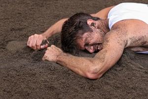 Thomas van der Plaetsen of Belgium lays injured as he competes in the men's decathlon long jump.