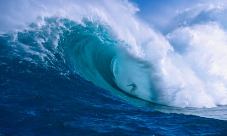 Surfer shooting the curl of Jaws at Peahi on Maui