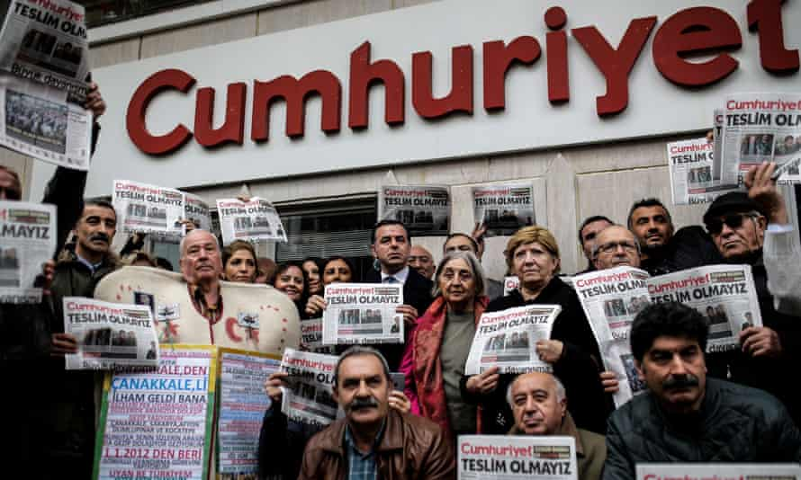 Protesters hold copies of the Cumhuriyet during a demonstration in Istanbul in 2016