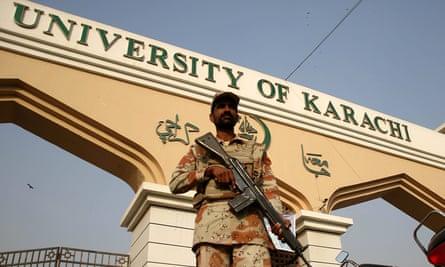 A Pakistani soldier stands guard outside the University of Karachi following an attack on Bacha Khan University.
