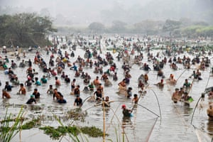 Villagers participate in a community fishing event at Goroimari Lake in Assam, India
