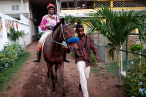 Jerome Innis being led on to the track by groom Anthony Getford
