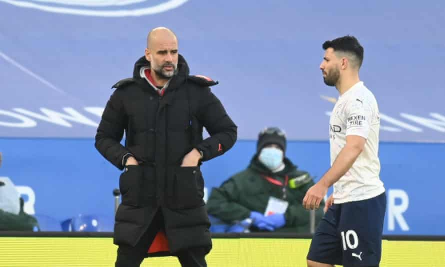 Manchester City's Sergio Agüero walks by Pep Guardiola after being substituted off in the win at Leicester City.
