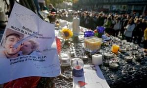 Flowers and candles at the Place de la Republique square.