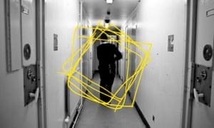 Prison worker walking down corridor