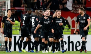 Frankfurt's Nicolai Mueller celebrates with teammates after scoring the his side's third goal.