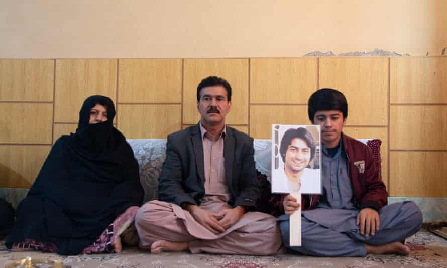Professor Wahid with his wife, youngest son who also is holding the picture of missing Rehmatuallah