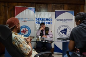 Dr. Álvaro Leiva, 55, assisting two newly-arrived Nicaraguan journalists at the office of the Nicaraguan Association for Human Rights in San José.