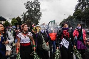 EcuadorWomen perform during the march in Quito.