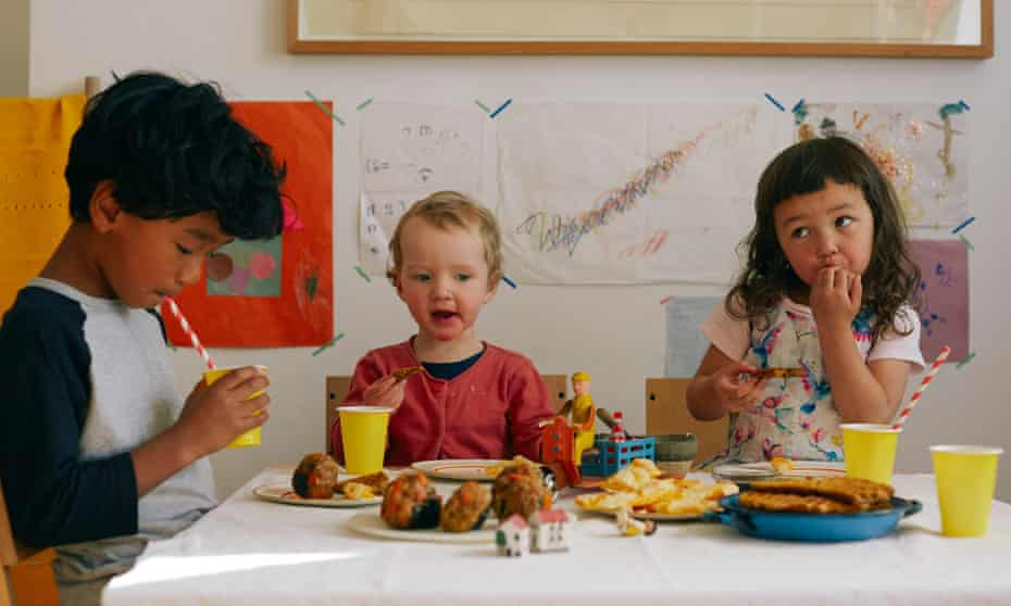 children eating a meal at a table