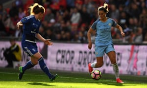 Carli Lloyd of Manchester City attempts to take the ball past Aoife Mannion of Birmingham City.