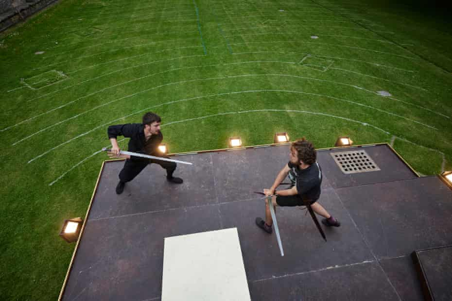 Ronnie Yorke (Macbeth) and Maximillian Marston (Macduff) practice their climactic swordfight, before audiences are admitted for the evening. Production Manager Aaron Barker draws guidelines at every venue, to ensure that audience members are able to seat themselves one metre apart from each other, for Covid-safe social distancing.