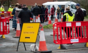 People waiting to be tested at a Covid-19 mobile testing unit set up at the White Hart pub in Fernhill Heath, near Worcester.