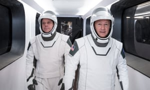 SpaceX astronauts Bob Behnken and Doug Hurley, wear white SpaceX spacesuits.
