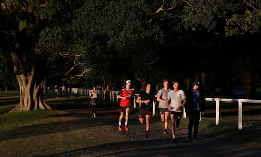 People exercise in Centennial Park amidst the easing of restrictions implemented to curb the spread of the coronavirus disease in Sydney, Australia