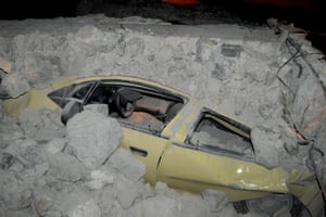 A car is covered with debris following the earthquake on the island of Kos