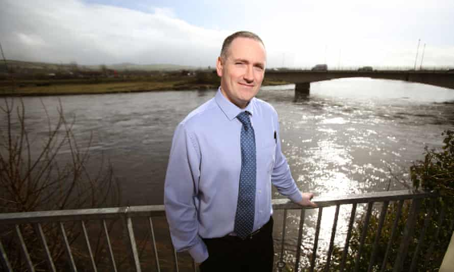 Pharmacist Robert Wilson with the River Foyle behind him in the border town of Lifford, County Donegal, Ireland.