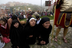 Women plays the role of Las Tres Marias, or the three Marias, in a Good Friday reenactment in La Paz, Bolivia.