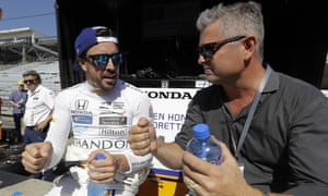 Fernando Alonso discusses tactics Gil de Ferran during a practice session for the Indianapolis 500