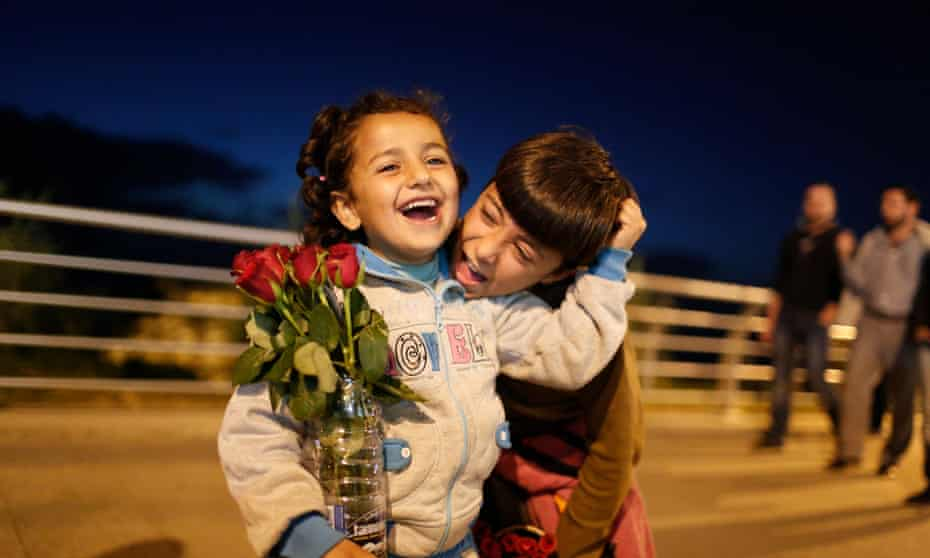Six-year-old Nirmeen, from Aleppo, takes a break from selling roses on the Beirut seafront