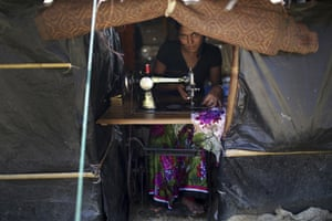 A Rohingya Muslim woman works on her sewing machine inside her tent at Kutupalong refugee camp.