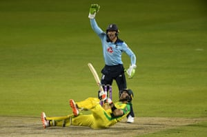 Glenn Maxwell of Australia falls over whilst attempting a reverse sweep as Jos Buttler of England appeals for LBW.