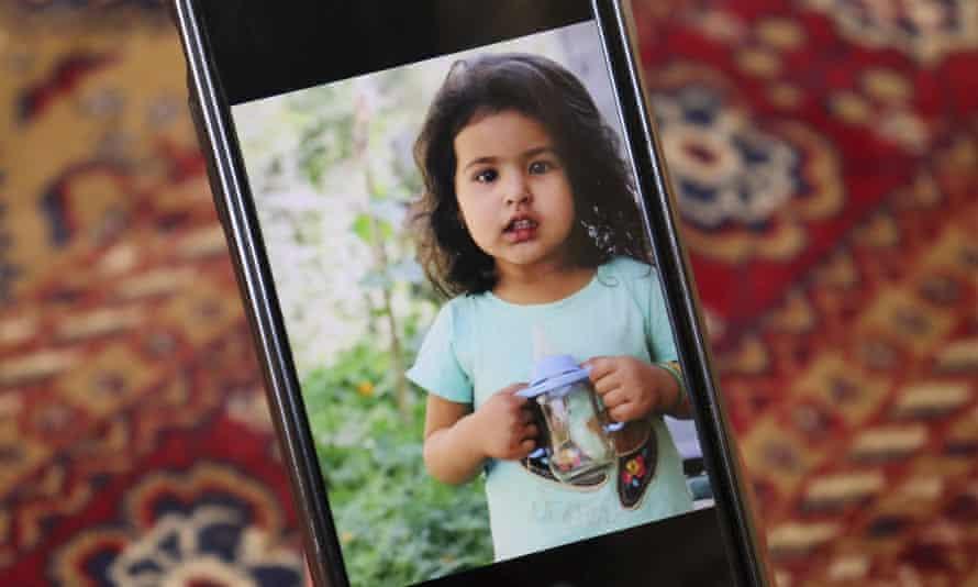 Emal Ahmadi shows a photo of his family member who was killed during a US drone strike on their home in Kabul.