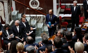 Edouard Philippe is applauded after his speech at the National Assembly in Paris on Tuesday.