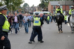 A fan is stopped by police near the away fans entrance before the Sheffield Wednesday v Sheffield United derby.