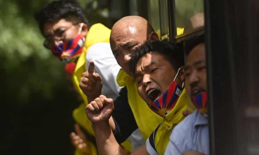 Activists of the Tibetan Youth Congress (TYC) after being detained by police during a protest outside the China embassy in New Delhi on the 100th anniversary of the founding of the Chinese Communist party.