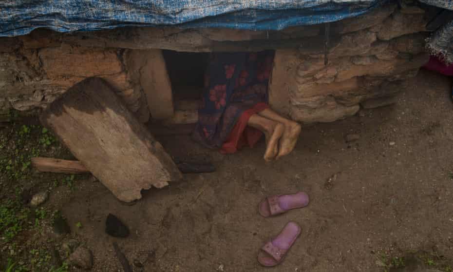 A woman enters a 'period hut' in Mastamandali village in Nepal's Accham district