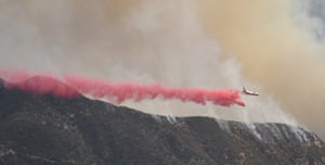 Air tankers make drops on a fast-moving brush fire in the Angeles National Forest