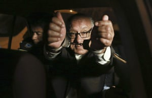 Judge Juan Gonzales shows his handcuffs to the press after he was detained by anti-corruption police officers in Lima, Peru.