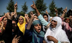 Kashmiri women attend a protest after Eid-al-Adha prayers at a mosque in Srinagar during restrictions after the scrapping of the special constitutional status for Kashmir by the Indian government