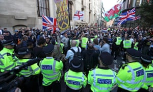 Supporters of Tommy Robinson wave flags as they demonstrate outside the Old Bailey.