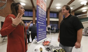 A recruiter from a driller in the shale gas industry, left, speaks with an attendee at a job fair in Cheswick, Pennsylvania.